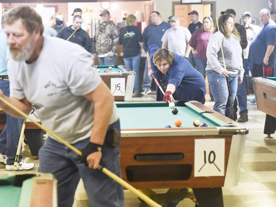 Janet Neice of Pearisburg makes her next shot during a doubles 8-ball game at a regional pool tournament held at the Loyal Order of Moose Staunton Lodge 1635 on Saturday, Jan. 9, 2016.