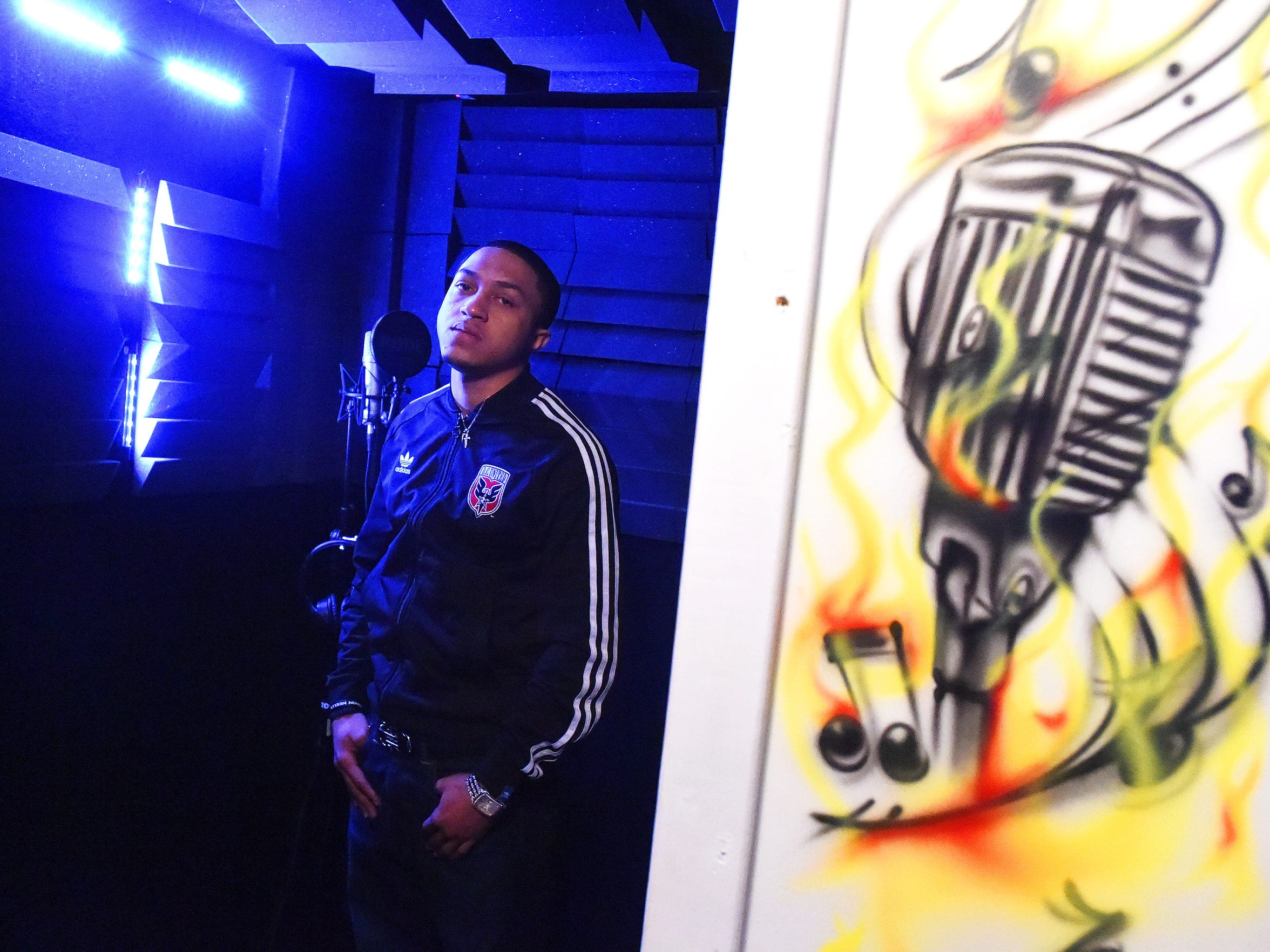Hip hop musician Rakeem Moats, aka Roc Rizzy, stands inside the recording booth for Cash Cow Entertainment in Staunton on Jan. 14, 2016.