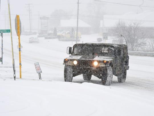 A National Guard humvee turns around on U.S. 250 as