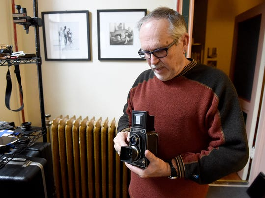 Photographer Richard Pippin talks about one of the cameras in his collection in Staunton on Tuesday, Jan. 26, 2016.