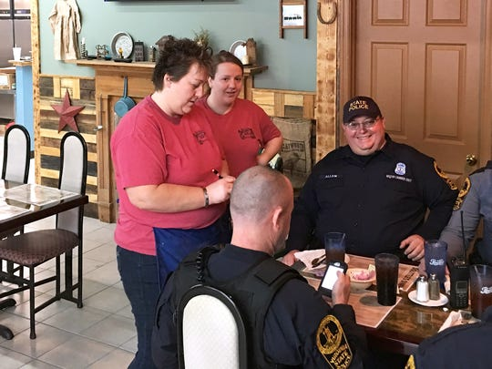 Trooper Jerry Allen (right) with the Virginia State Police smiles as business co-owner Tammy Johnson (left) and waitress Brandy Bryant take the order for those at the table during lunch at DoLittle's Diner on U.S. 340 in Stuarts Draft on Wednesday, Feb. 3, 2016. Tammy owns the business with her husband, Billy Ray Johnson.