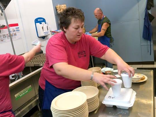 Tammy Johnson prepares to take a to-go order out to