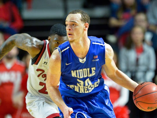In January, Blue Raiders forward Reggie Upshaw (30) brings the ball up court against Western Kentucky Hilltoppers. Middle Tennessee won 66-64.