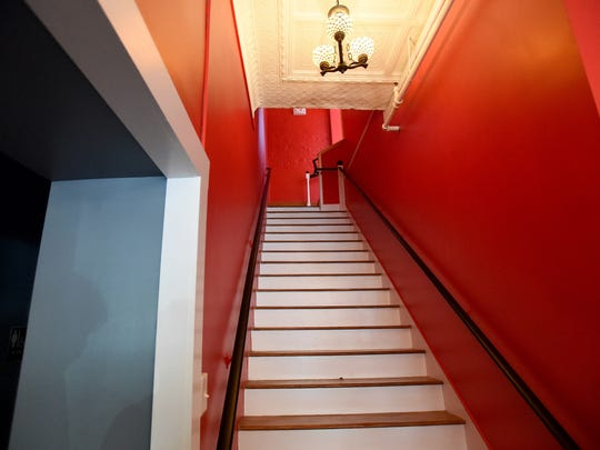 Stairs leading to the upstairs dining room.