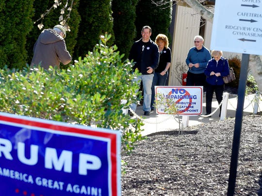 Jaime and Rhea Higginbotham of Stuarts Draft exit the Ridgeview precinct alongside Robert and Lola Thomas of Stuarts Draft after voting in the primary elections on Tuesday, March 1, 2016.