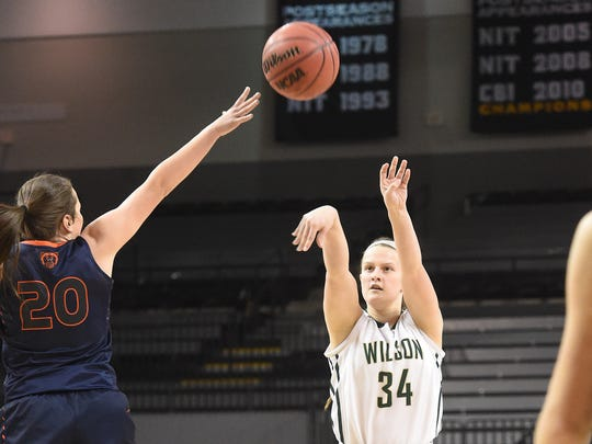 Wilson Memorial's Chridan Hatfield attempts a three point shot as Union's Kristen Bishop tries to block the shot during the Group 2A state semifinals played in Richmond on Thursday, March 10, 2016.