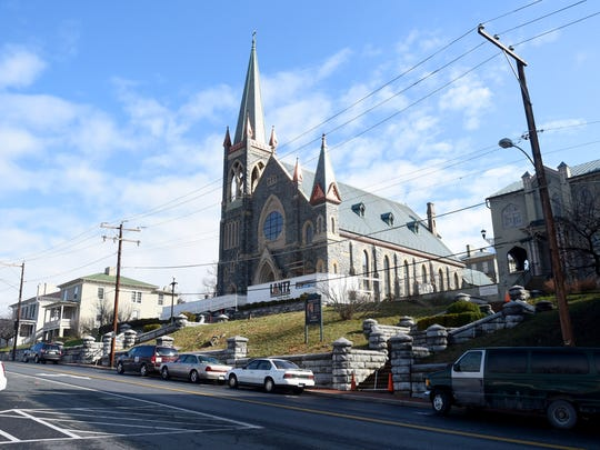 After months, the scaffolding which surrounded St. Francis of Assisi Catholic Church is all but gone as exterior renovations near completion. The church is viewed in downtown Staunton on Tuesday, March 15, 2016.