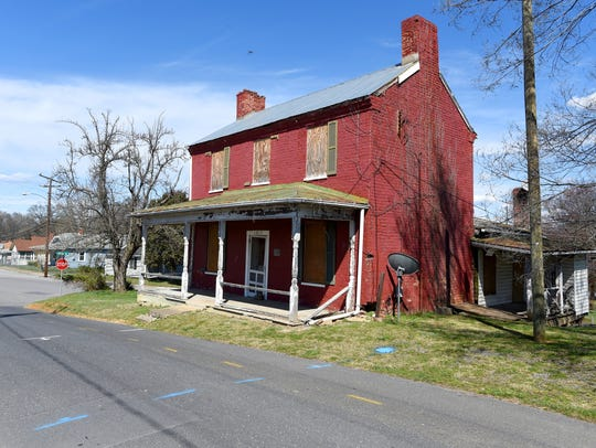 The 19th-century red brick Arnold House  located on