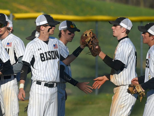 Buffalo Gap players greet one another as they come together as they leave the field for their turn at bat in the bottom of the second inning during a baseball game played in Swoope on Tuesday, April 5, 2016.