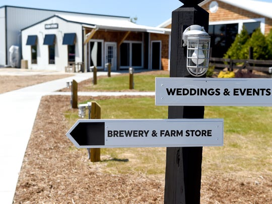 A sign points the way to Stable Craft Brewing and farm