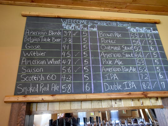 A board advertises available beverages in the tasting room at Stable Craft Brewing, located at Heritage Hill Farm and Stables on Madrid Road in Augusta County.