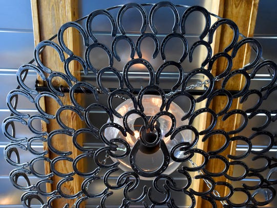 Horseshoes form a chandelier in the tasting room at