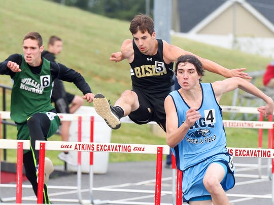 Buffalo Gap's Logan Miller jumps a hurdle as he races between William Monroe's Drew Tate and Page County's Kyle Biller in the boys' 110 meter hurdles during the 28th annual Augusta County Invitational Track Meet held in Greenville on Friday, April 29, 2016.