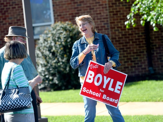Terry Boyle works the polls for her husband, Bob Boyle,