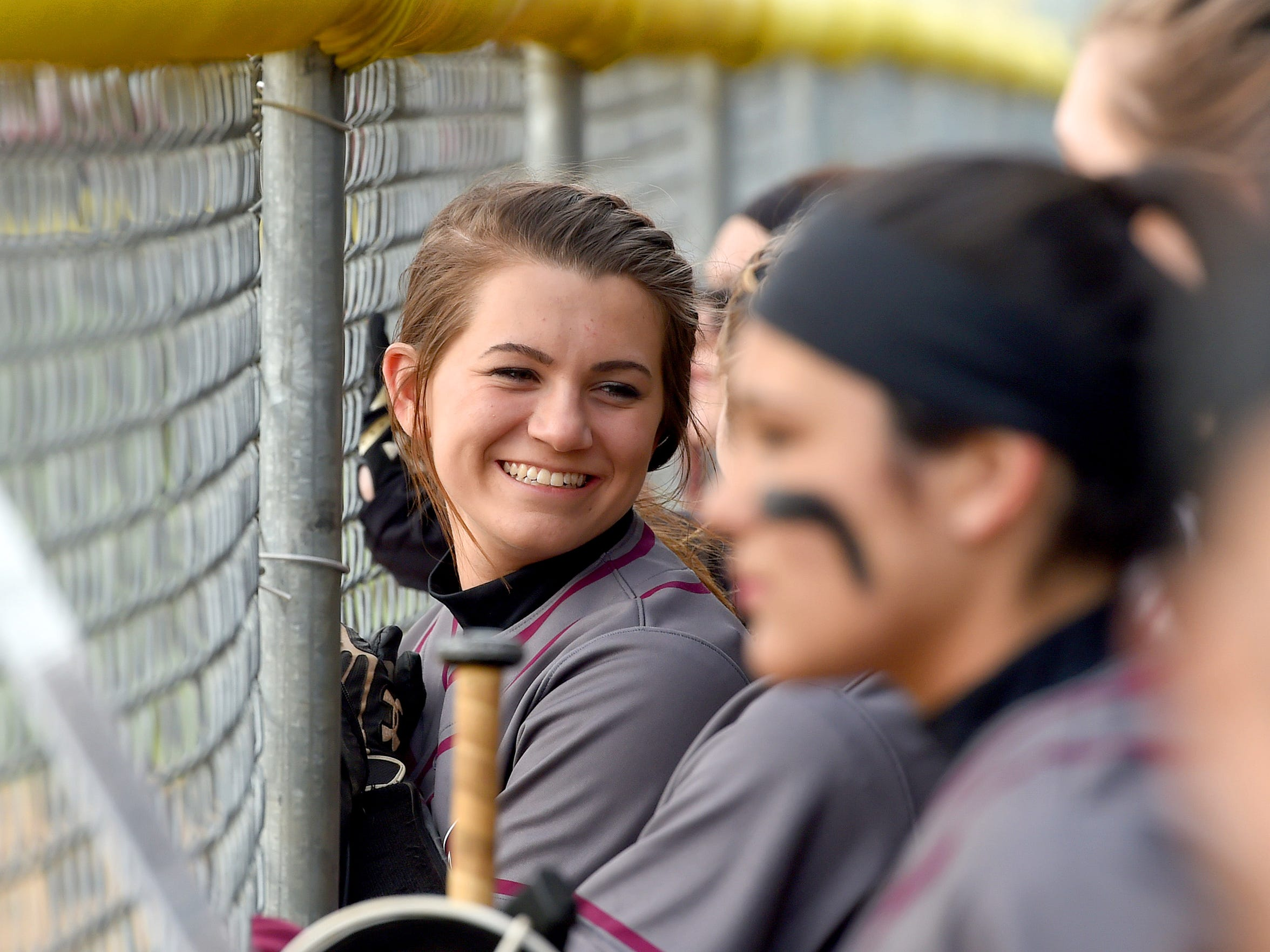 Stuarts Draft's Kayley Campbell smiles as she converses with a teammate in the dugout during a softball game played in Waynesboro against Waynesboro High School on April 6, 2016.