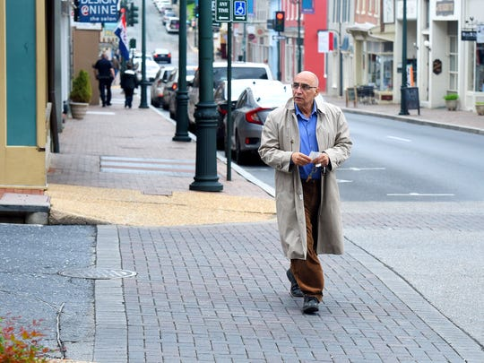Ghiyasuden Sadr of Staunton uses the crosswalk as he crosses Augusta Street while walking the sidewalk along Beverley Street in downtown Staunton on Wednesday, May 18, 2016.