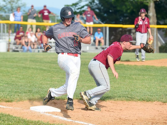 Riverheads' Ridge Stokes hustles as he tries to beat the throw at first base but is unsuccessful in the third inning during the Conference 44 championship baseball game played in Greenville on Wednesday, May 25, 2016.