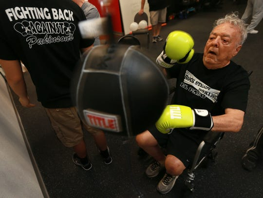 Joseph Blot works on a small punching bag during his
