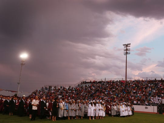 Clouds loomed nearby as the Ysleta High School graduation