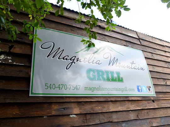 Sign on the side of the Magnolia Mountain Grill food