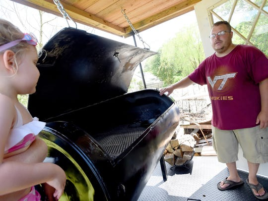 Andy Price  talks about the grill he constructed from