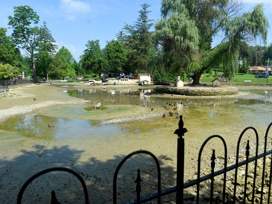 Most of the water is gone from the duck pond in Gypsy Hill Park after it sprung a leak with most of the water draining out on Friday, July 1, 2016.