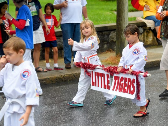 """Little Tigers"" from Grandmaster Dong's Martial Arts school  walk the parade route with other students from the school. America's Birthday Celebration held its annual parade in Gypsy Hill Park on Monday, July 4, 2016."