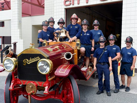 Inspired by an old photo, fire fighters with the Staunton