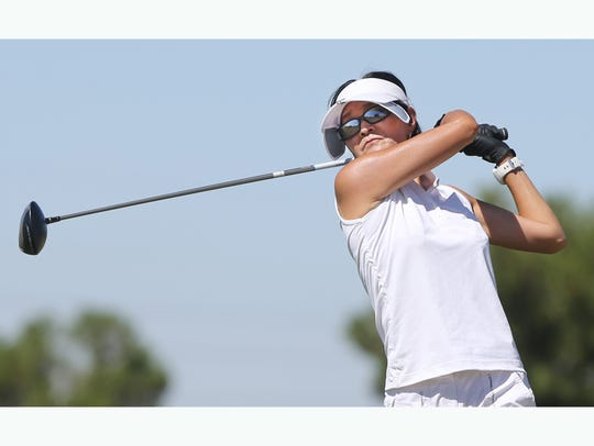 Soo Lee watches her drive head down range Friday during