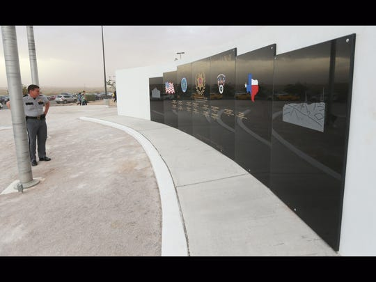Sheriff Richard Wiles pauses in front of the El Paso County Law Enforcement Memorial Wall.