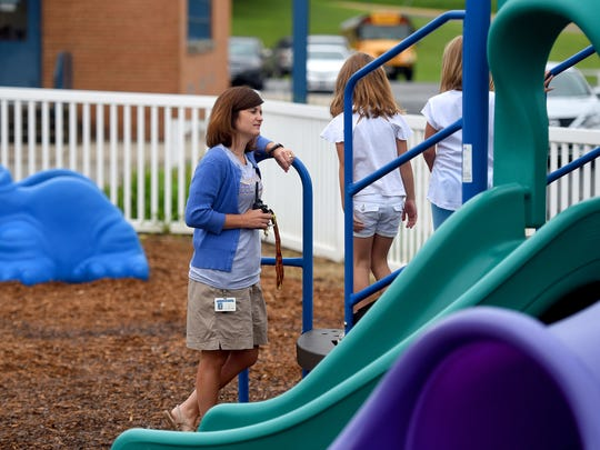 Principal Miranda Ball takes a moment to socialize with some of the first-graders during their recess on the first day of school on Tuesday, Aug. 9, 2016. This year marks the last year for Beverley Manor Elementary as the school closes end of the school year.