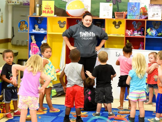 Teacher Katie Moran leads the 3 and 4-year-old students