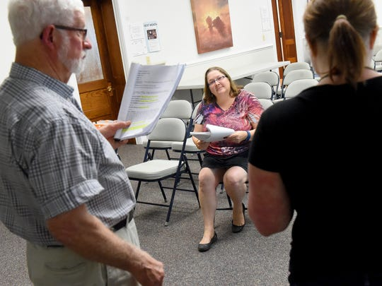 "Rosalind Collins listens as Tom Cabe portrays ""second trooper"" and Tilly Sandaker portrays ""first trooper"" while running lines at the Staunton Public Library on Monday, Aug. 22, 2016. Rosalind serves as director for ""3 Filosofers in a Firetower"" which was written by her grandmother, Margaret Collins in 1962. The play is set to be performed on Sept. 3 and 4 at Oak Grove Theater."