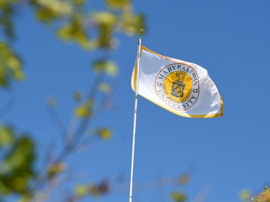 The Mary Baldwin University flag is raised on campus during the university's launch and charter day ceremony on campus in Staunton on Wednesday, Aug. 31, 2016.