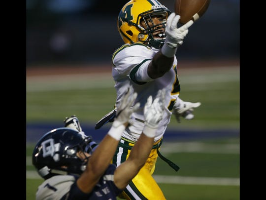 Mayfield defensive back Steven Gay, top, reached out