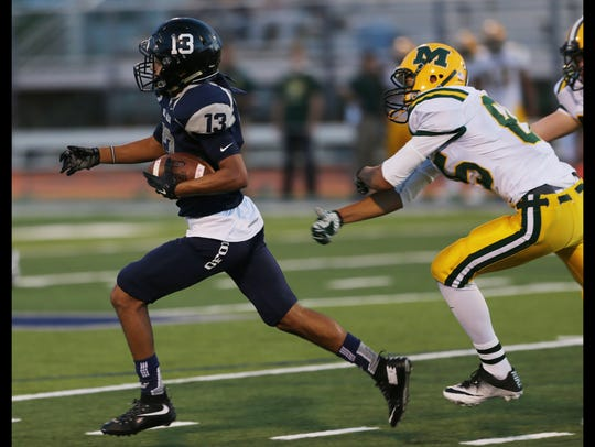 Del Valle kickoff returner Jose Valenzuela, left, runs