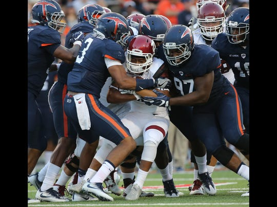 UTEP defenders stopped New Mexico State ballcarrier