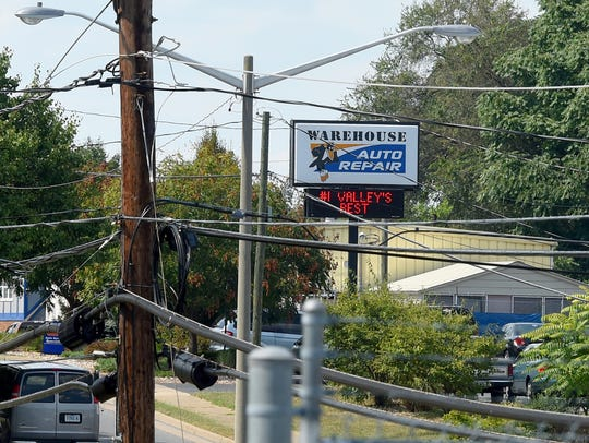 The electronic sign for Warehouse Auto Repair changes