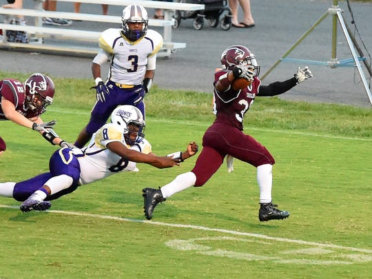 Stuarts Draft's Izzy Johnson slips away from Waynesboro's Alijah Braxton as he slips into the end zone for a touchdown during a football game played in Stuarts Draft on Friday, Sept. 9, 2016.