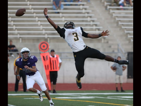 Parkland's Deion Hankins leaps for a pass as time runs