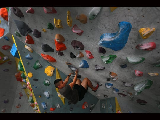 Gerardo Gonzalez climbed a wall at Cave Climbing Gym.