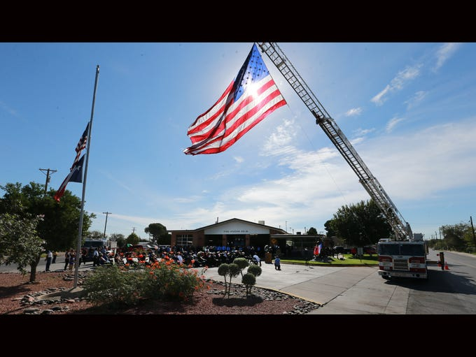 A large U.S. flag flew over fire station 18 for the
