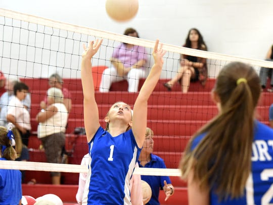 Fort Defiance's Madi Kimmel practices setting the ball during warmups before the start of their Volleyball game against Riverheads High School in Greenville on Sept. 8, 2016.