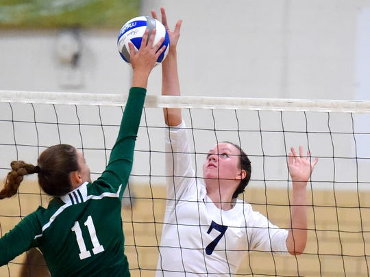 Robert E. Lee's Nellie Garrison battles  Broadway's Jaelynn Rogers at the net on which way the ball will go during a volleyball game played in Staunton on Tuesday, Sept. 13, 2016.