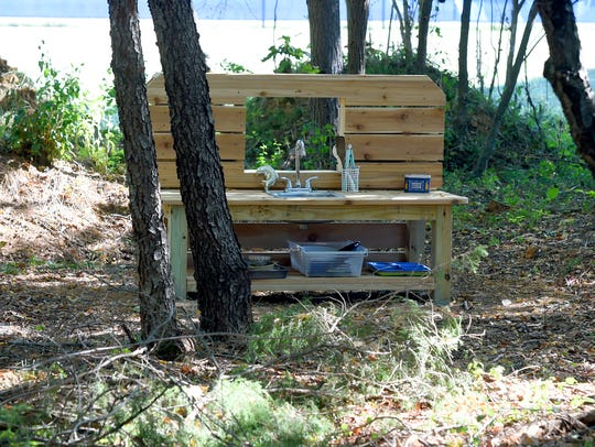 """The """"dirt kitchen"""" located under the trees in the natural"""