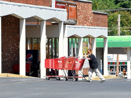 Shopping carts collected from the parking lot are rolled past Family Dollar and towards Big Lots at Chestnut Hills Shopping Center in Staunton on Wednesday, Sept. 14, 2016. Since then, the two stores have closed.