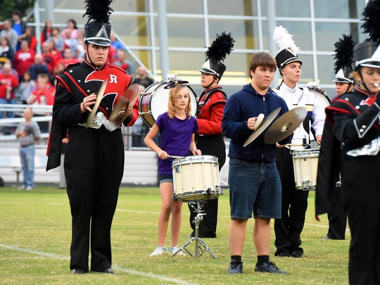 The Kate Collins Middle School band joined the marching bands from Waynesboro and Riverheads high school on field for the playing of the national anthem before the start of Friday's game in Waynesboro.