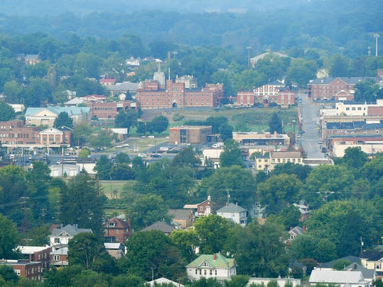 A view of Fishburne Military School and downtown Waynesboro as seen from the top of the future Sunset Park, being developed on the site of the city's old municipal landfill which closed in 2005. Photo was taken on Wednesday, Sept. 21, 2016.