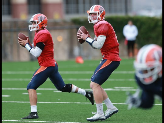 UTEP quarterbacks Zack Greenlee, left, and Ryan Metz go through passing drills on the Glory Road field.