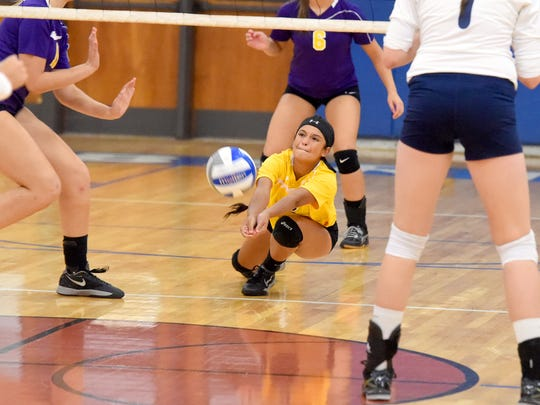 Waynesboro's Maryssa Jones dives after the ball to keep it in the air with a bump during a volleyball match played in Staunton on Thursday, Sept. 29, 2016.